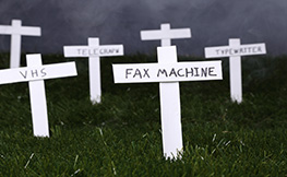 Photos of grave crosses with redundant technologies named.